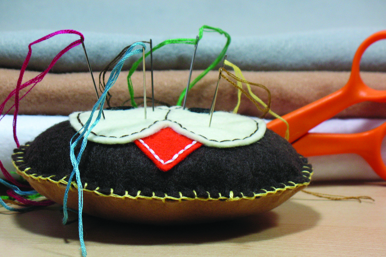embroidery needles in pin cushion